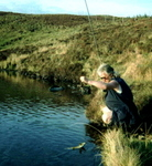 Landing a Brown Trout on Loch Nam Ban